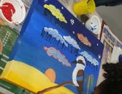 Painting a canvas for NAIDOC Week