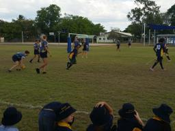 Staff and students playing a touch football game